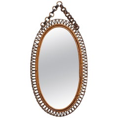 Italian Oval-Shaped Rattan Wall Mirror with Hanging Chain 'circa 1960s'