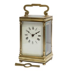 French Brass Cased Carriage Clock Standing on Bun Feet
