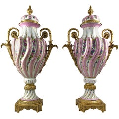 20th Century Pair of Ormolu Mounted Pink Sevres Vases with Lids