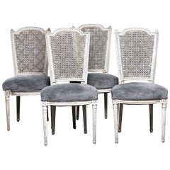 Set of Four French Painted Chairs with Upholstered Seats and Caned Backs
