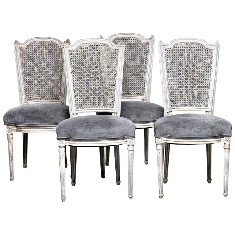 Set of Four French Painted Chairs with Upholstered Seats and Caned Backs For Sale