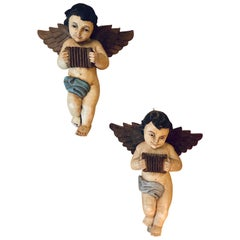 Pair of 19th-20th Century Continental Painted Antique Winged Babies or Cherubs