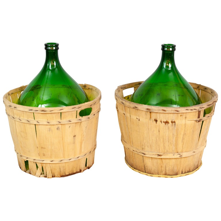 Large French Antique Emerald Green Demi-John in a Wooden Basket For Sale