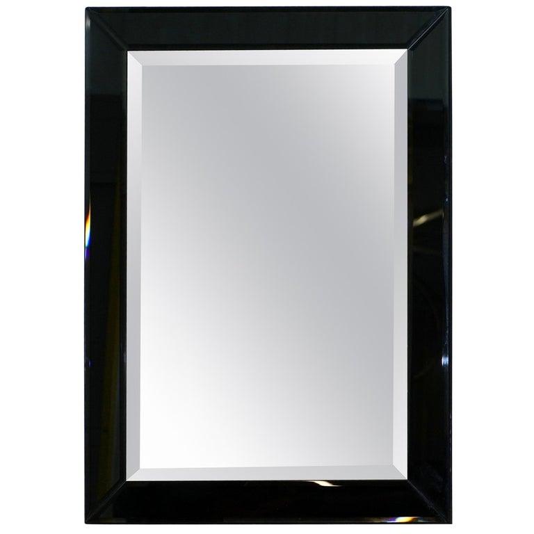 Lovely Bevelled Edge Mirror with Black Glass Bevelled Frame Velvet For Sale
