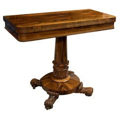 William IV Rosewood card table standing on a central pedestal and carved base
