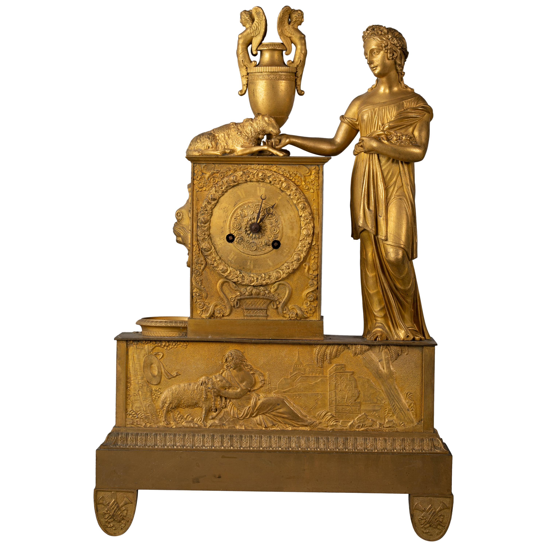 French Empire Gilt Bronze Figural Clock, circa 1820