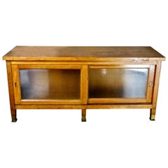1930s Mission-Style Oak Mercantile Cabinet with Sliding Glass Doors
