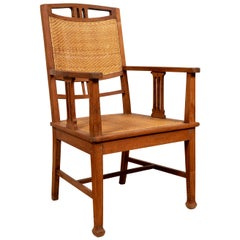 Dutch Colonial Javanese Teak Armchair with Rattan and Triglyph Inspired Motifs