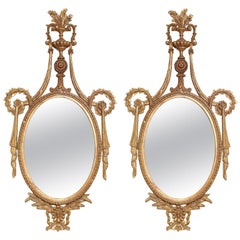 Pair of Classical-form Italian Carved Giltwood Oval Mirrors