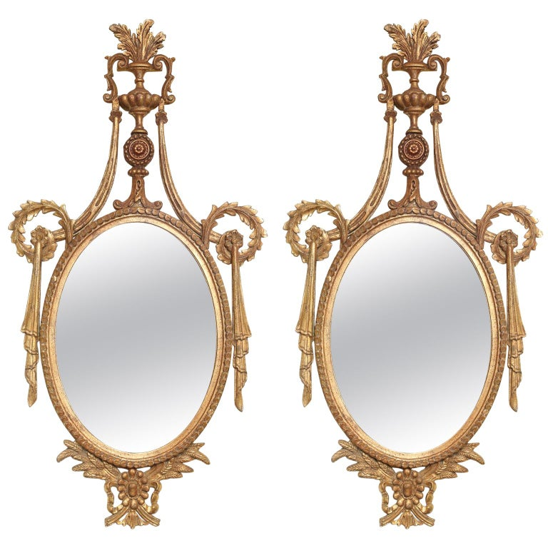 Pair of Classical-form Italian Carved Giltwood Oval Mirrors For Sale