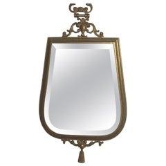 Mid-Century Modern Brass Wall Mirror in the style of Fonasetti, Milano. 1950s