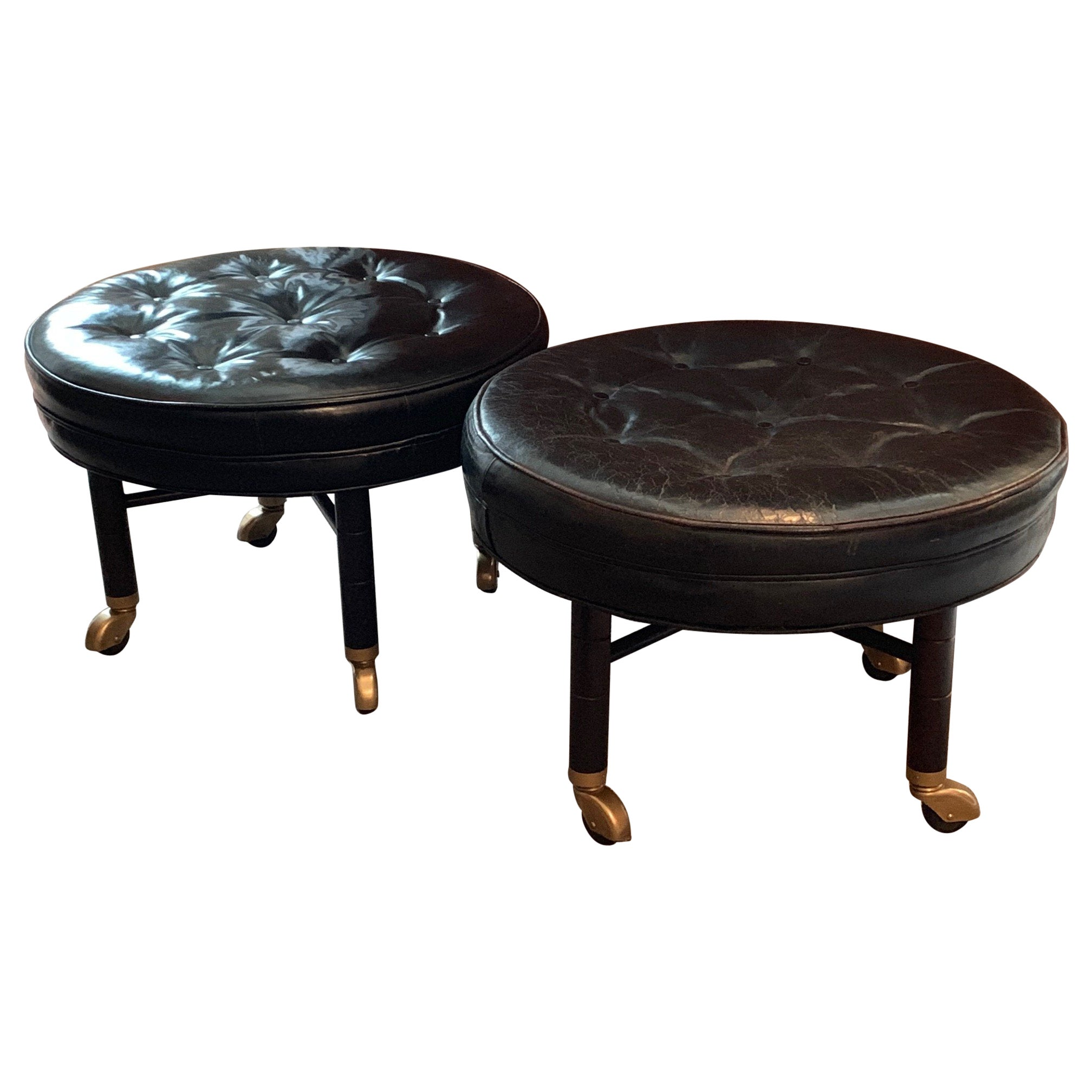 A Pair of Large Round Leather Ottomans by Baker