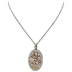 Diamond and 14-Carat Gold Oval Locket on Chain