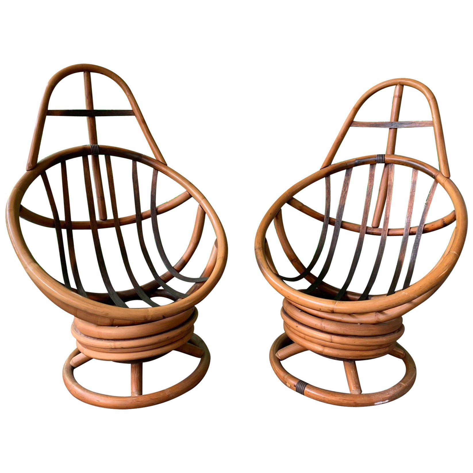 Pair of Midcentury Rattan Rocking Swivel Lounge Chairs