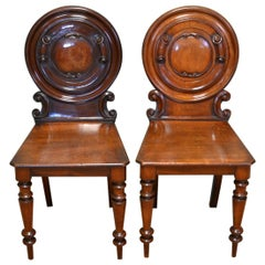 Unusual Pair Of Moulded Back Antique Mahogany Hall Chairs