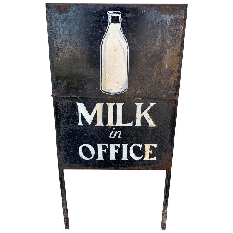 Vintage Newspaper and Milk Trade Sign