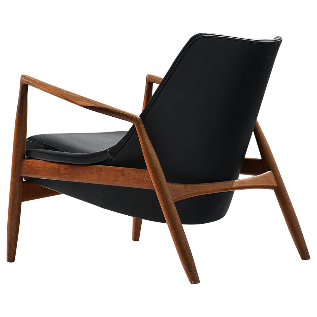 Ib Kofod-Larsen Black Leather Seal Chair in Teak