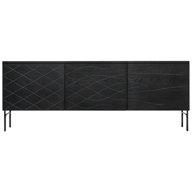 Credenza in stained black ash and blue stitching.