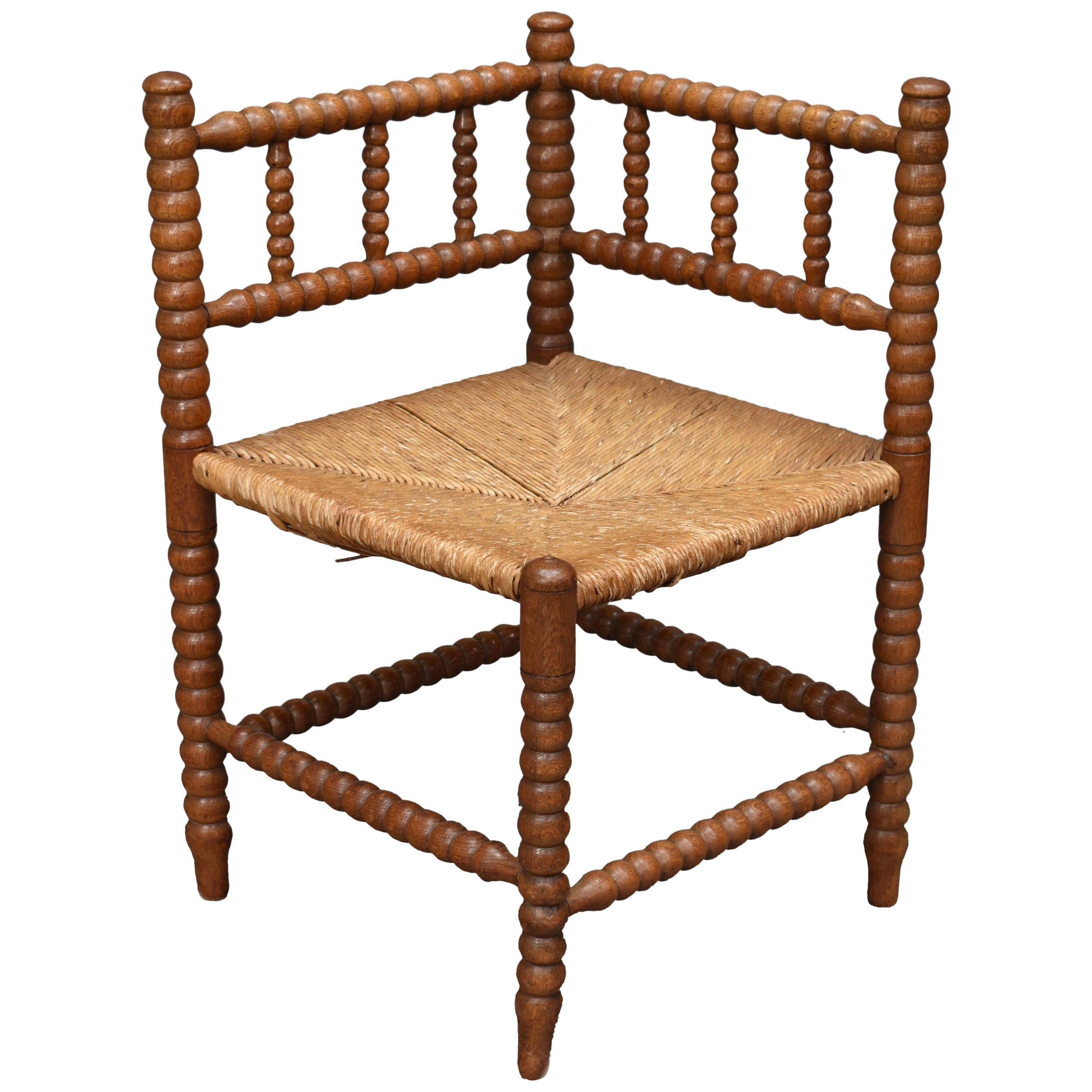 Stunning French Corner Chair in Turned Oak and Cane, France, 1930-1940