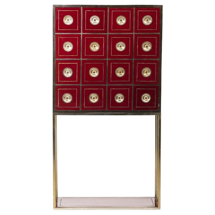 Brass and Burgundy Red Cabinet with 16 Drawers in the Style of Willy Rizzo