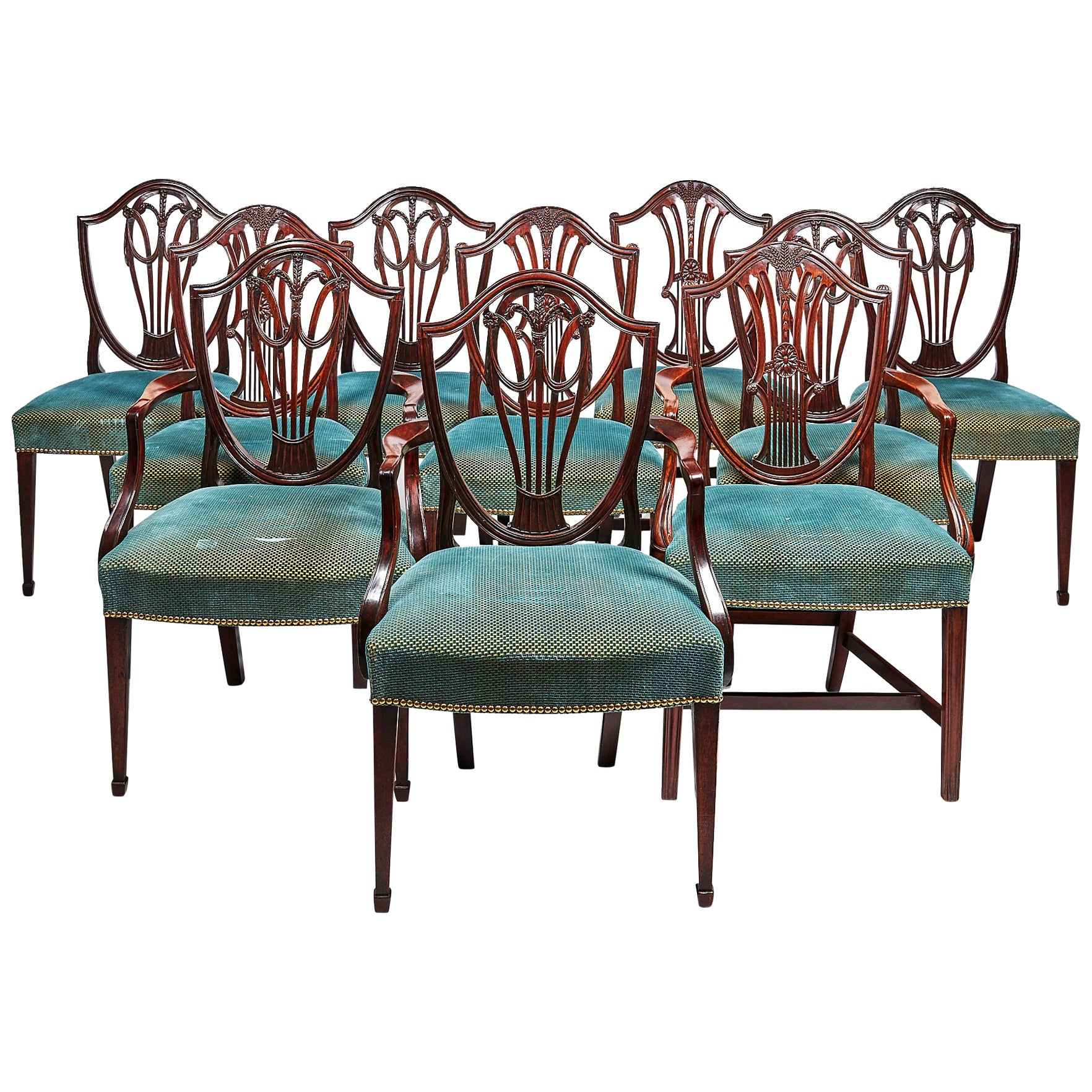 Ten George III Mahogany Dining Chairs in the Hepplewhite Style