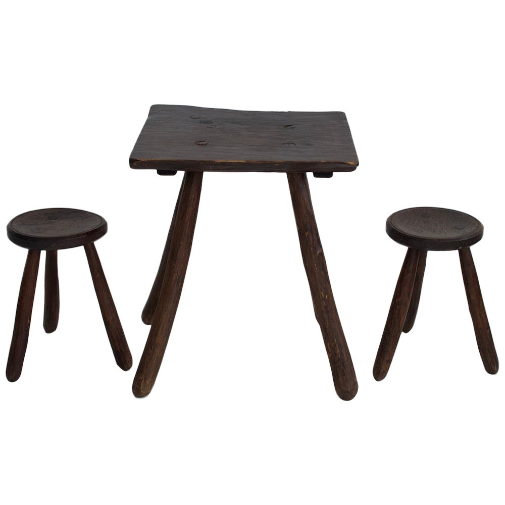 Rustic Table and Two Tripod Stools of Profiled Wood Logs