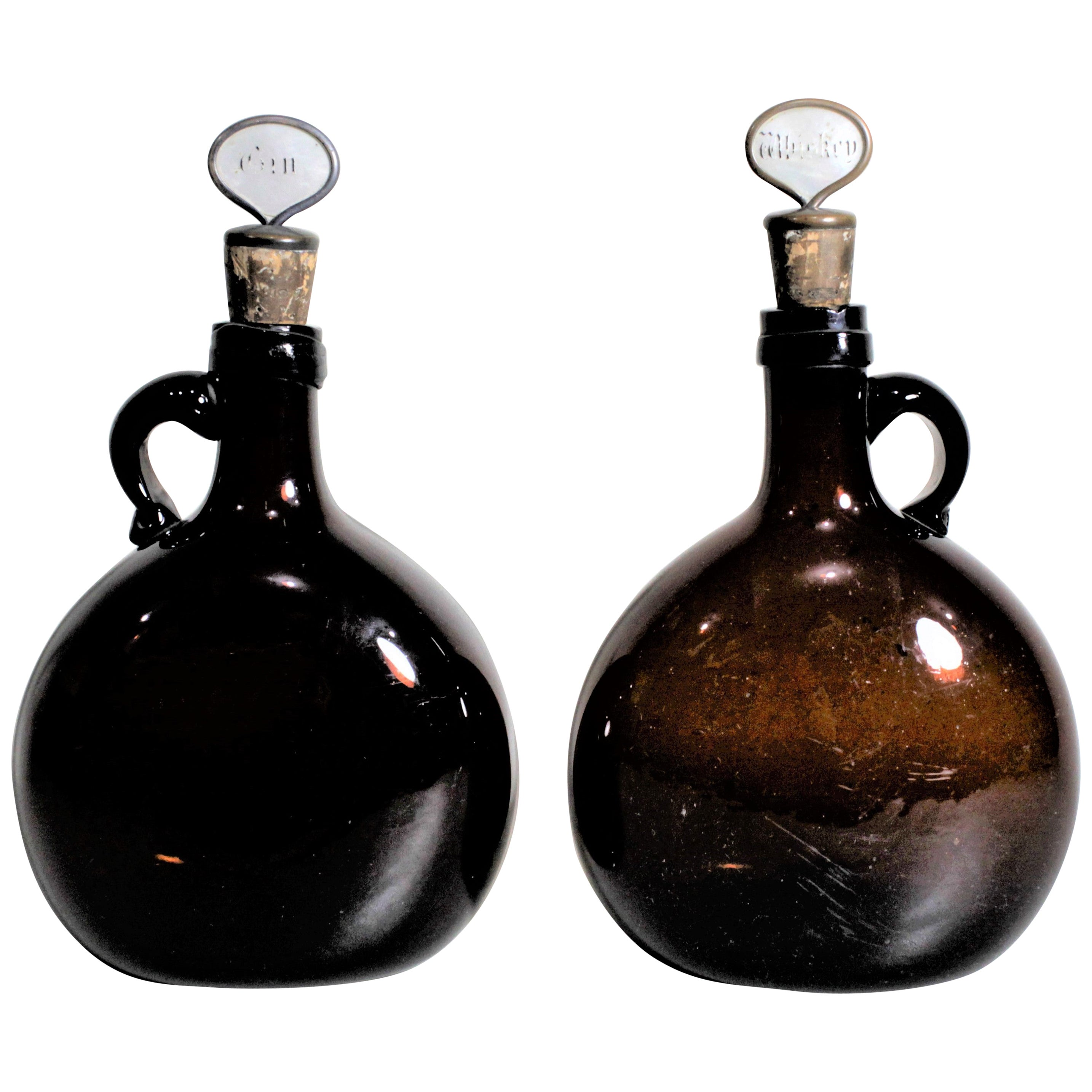 Pair of Antique Amber Glass Liquor Decanters with Mother of Pearl Stoppers
