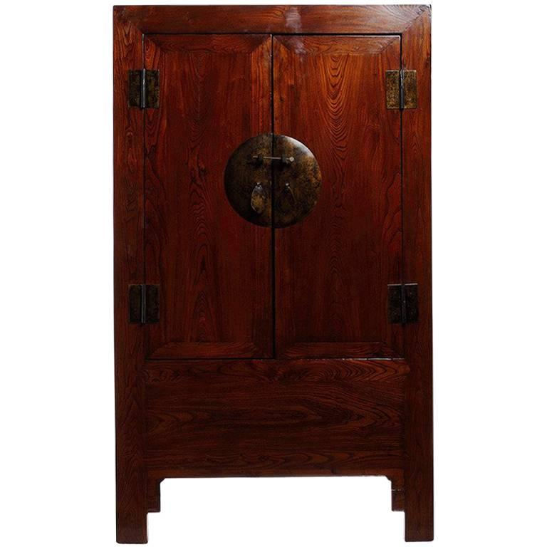 Brown Lacquer Elm Chinese Armoire from the 19th Century with Medallion Hardware For Sale