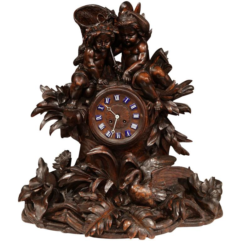Large 19th Century Swiss Black Forest Carved Walnut Mantel Clock with Cherubs