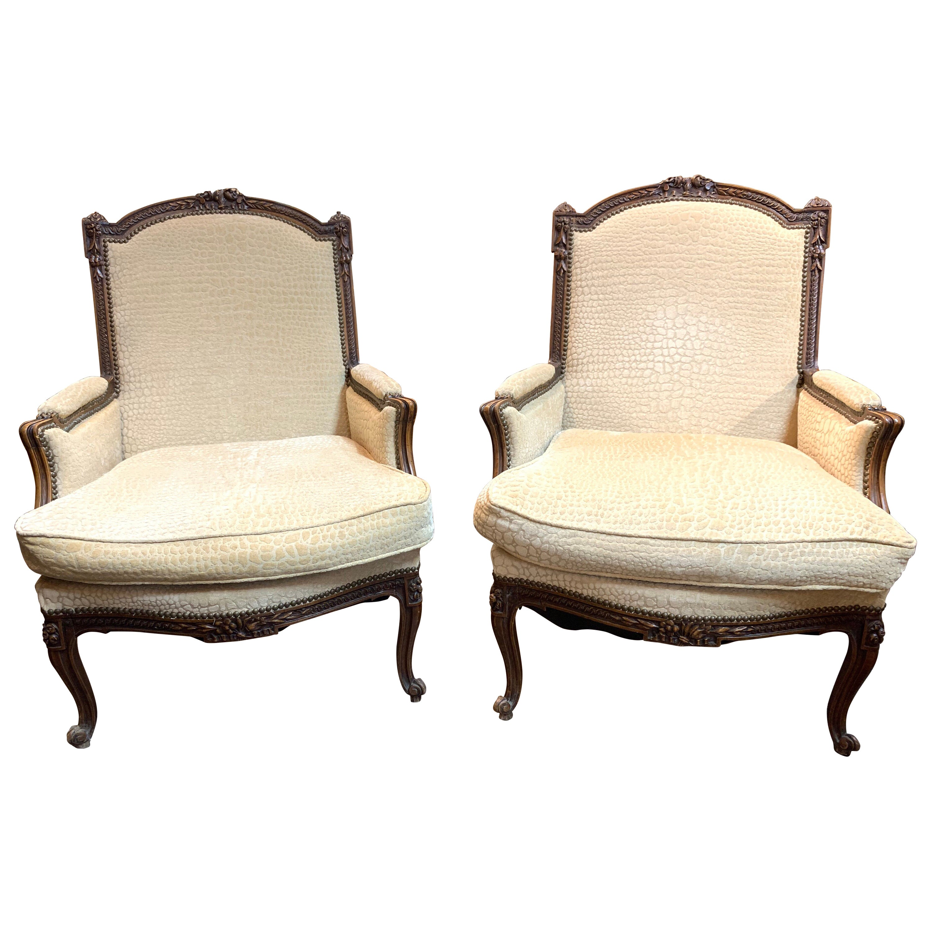 19th Century French Carved Walnut Upholstered Armchairs