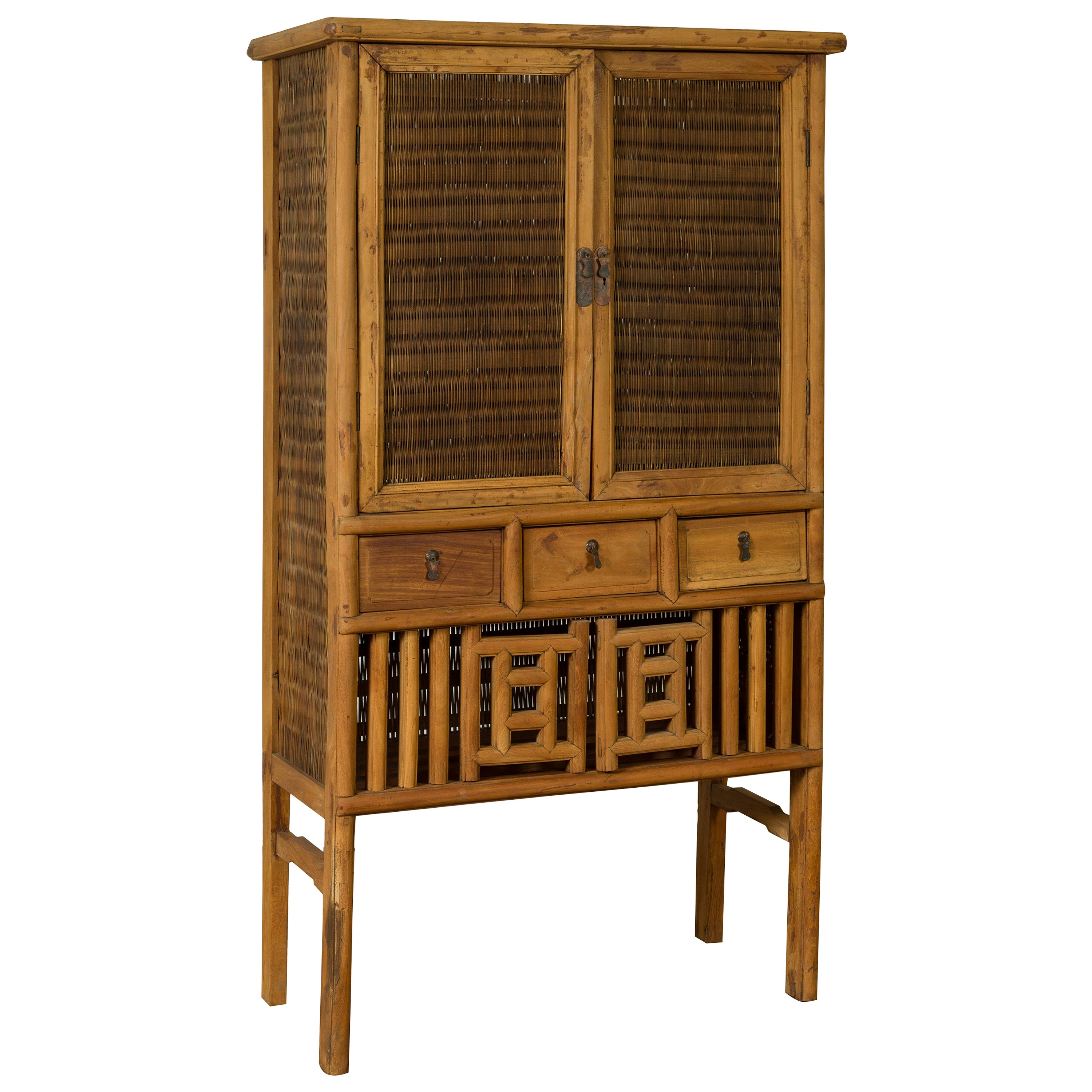 Indonesian Cabinet with Rattan Doors, Drawers and Fretwork Sliding Panels