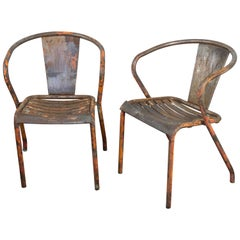 Pair of French Tolix Industrial Chairs with Distressed Orange Paint Finish