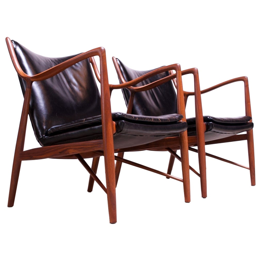 """Pair of Vintage Walnut and Leather """"45"""" Lounge Chairs by Finn Juhl for Baker"""