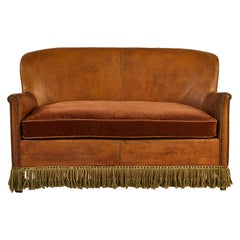 French Leather Settee with fringed Tassels
