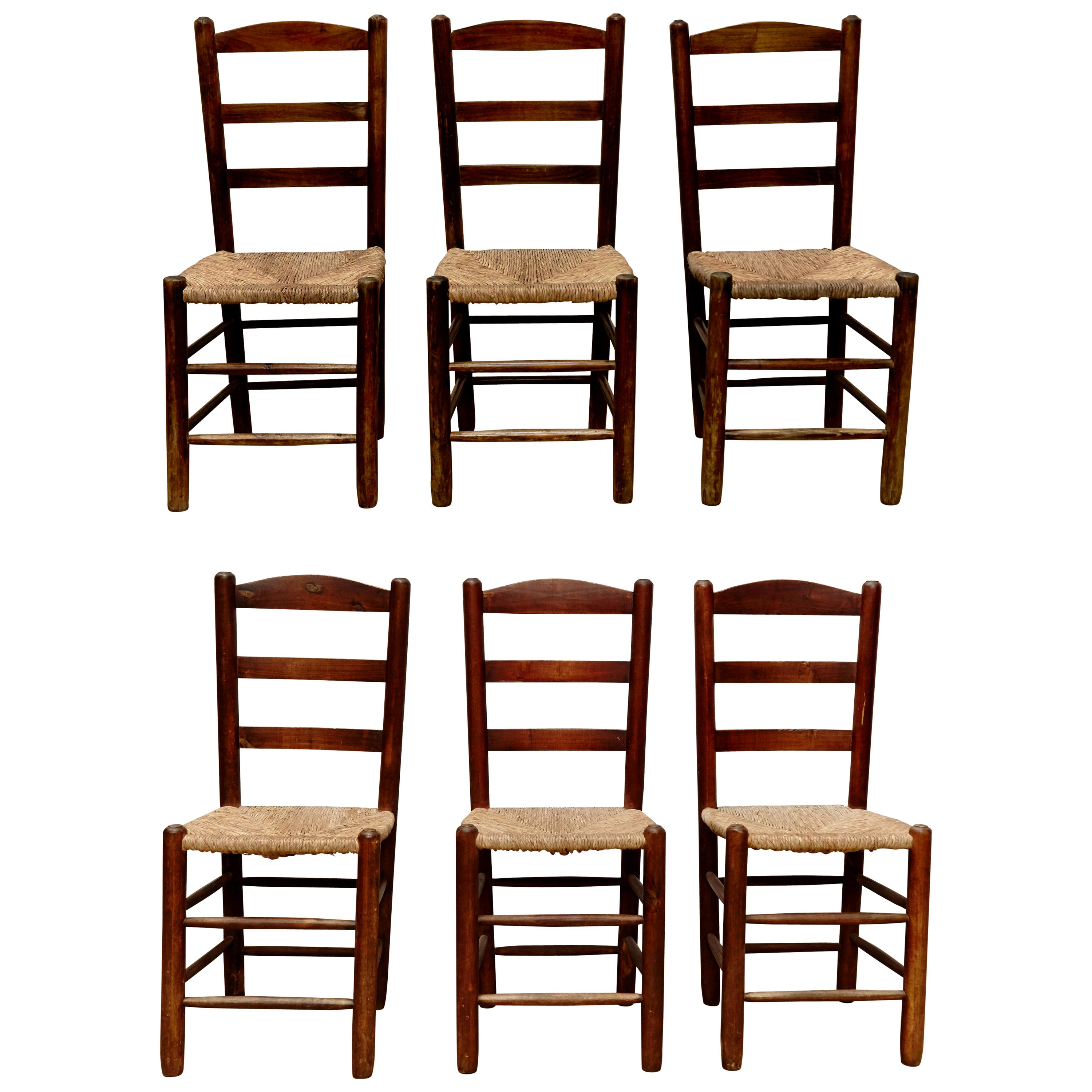 Set of Six Chairs after Charlotte Perriand in Wood and Rattan, circa 1950