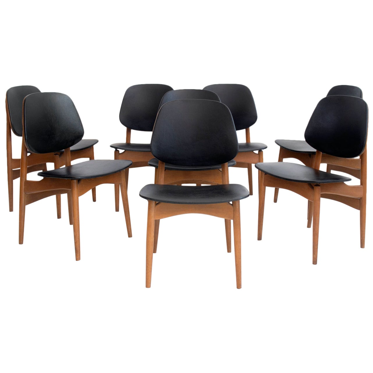 Set of Eight Black Faux Leather and Wood Dining Chairs