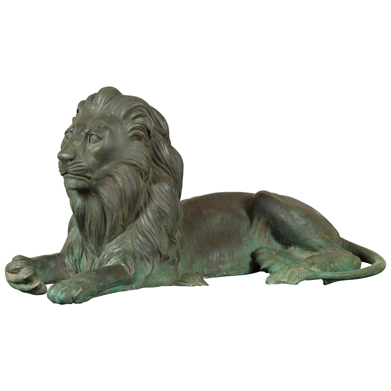 Vintage Cast Bronze Sculpture of a Reclining Lion with Verde Patina