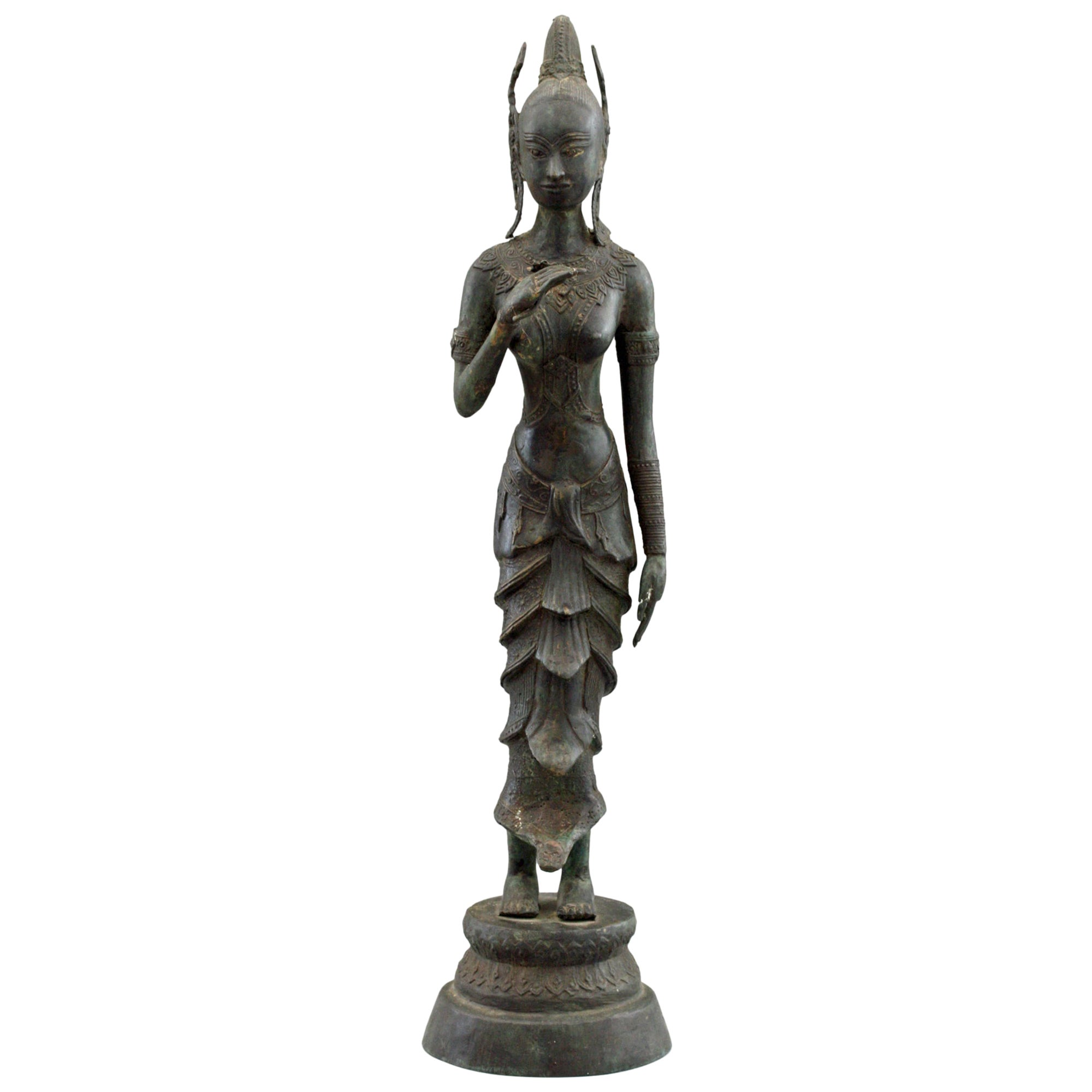 Indonesian Antique Bronze Figure of a Slender Goddess with Lotus Flower