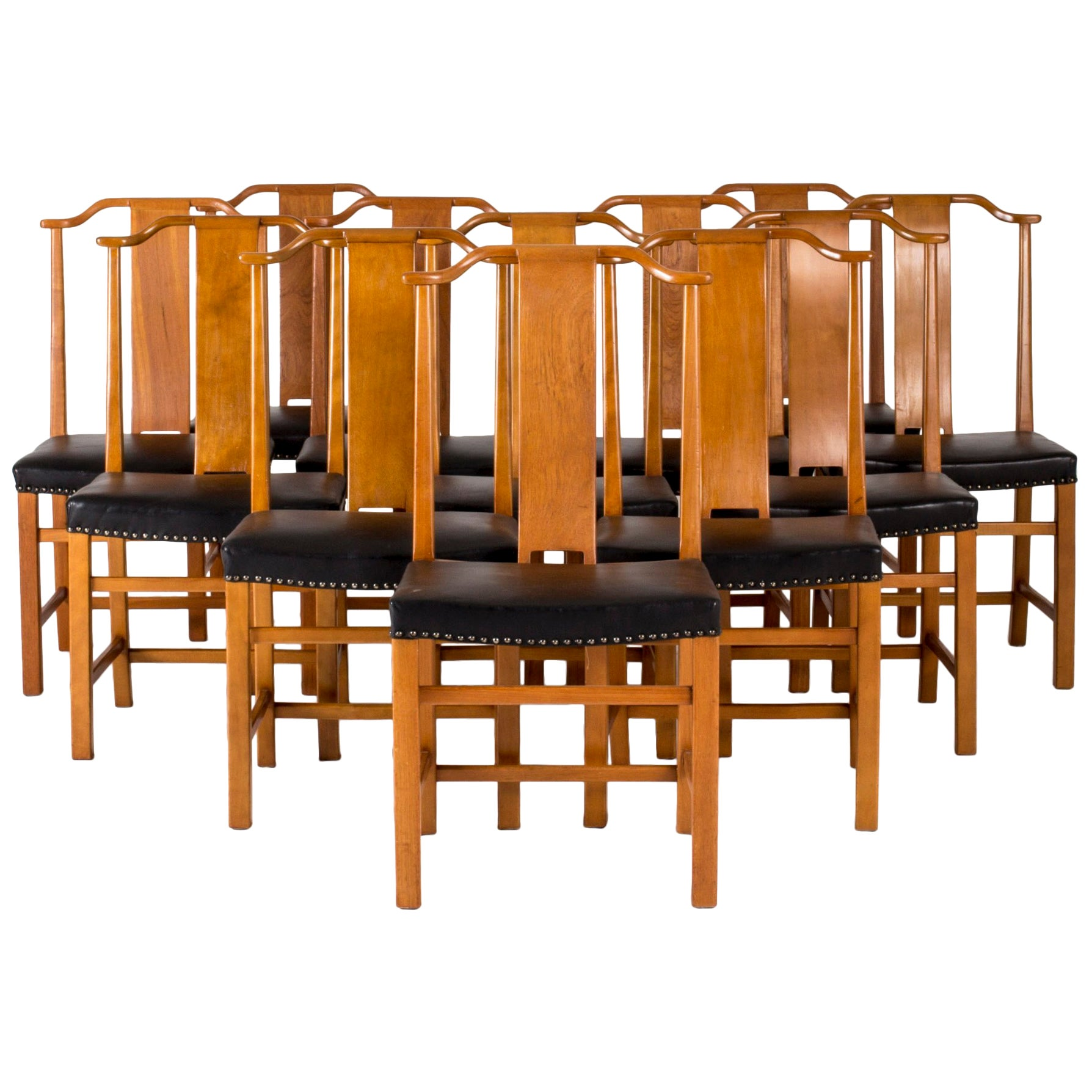 Set of 12 Dining Chairs by Axel Larsson