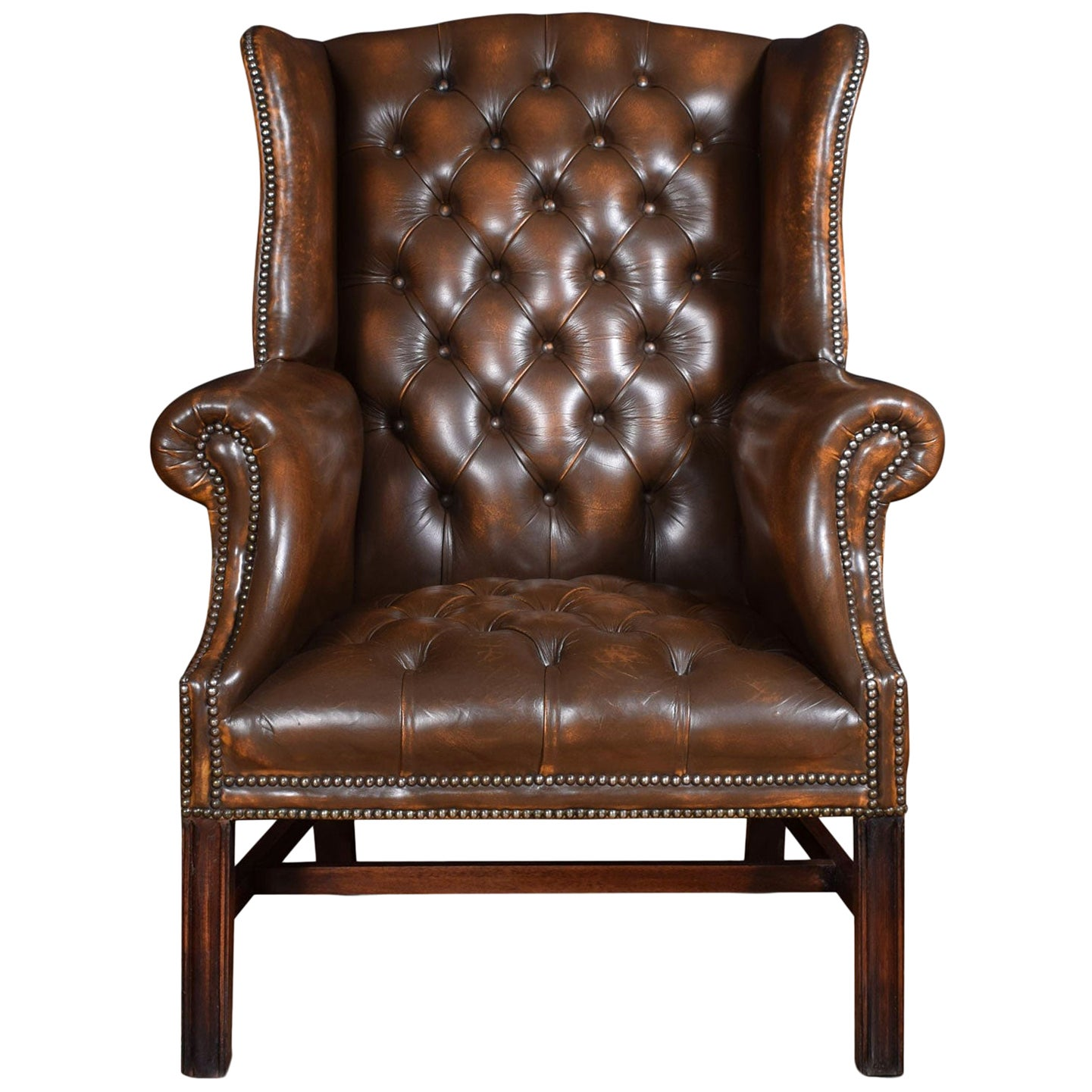 Brown Leather Upholstered Wingback Armchair