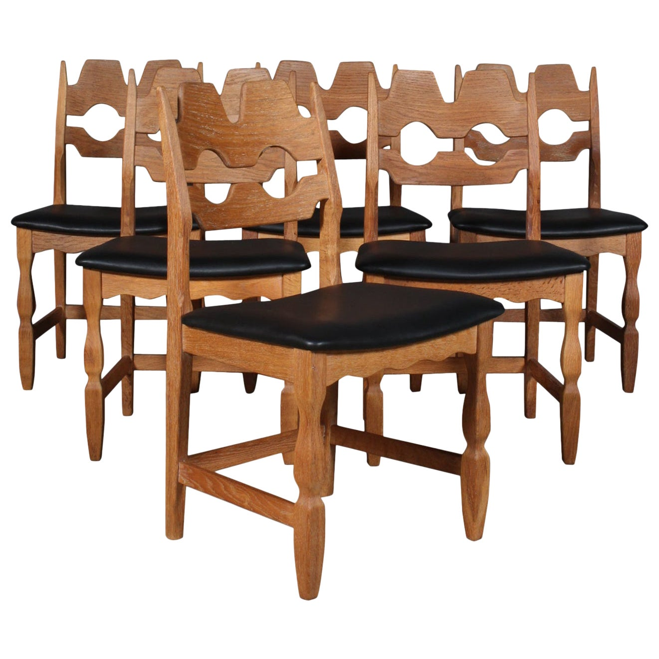Dining Chairs by Henning Kjærnulf