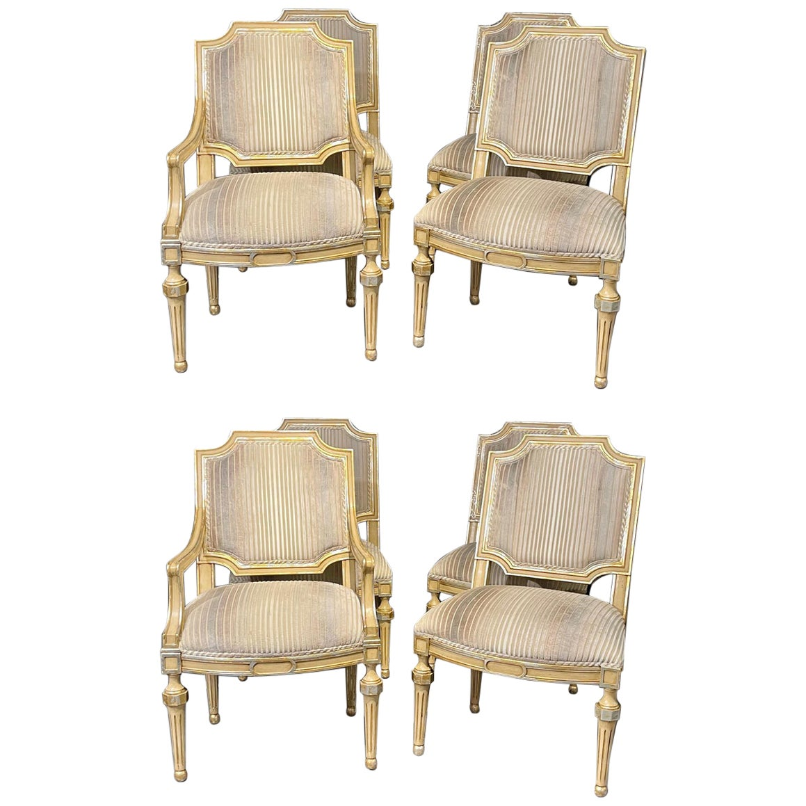 Set of Eight Louis XVI Style Dining Chairs Painted and Parcel-Gilt, Jansen Style