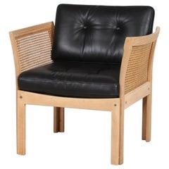 Illum Wikkelsø Plexus Chair of Oak with New Black Leather Upholstery, Denmark