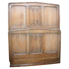 Heals, an Arts and Crafts Limed Oak Single Bed with Linenfold Carved Details