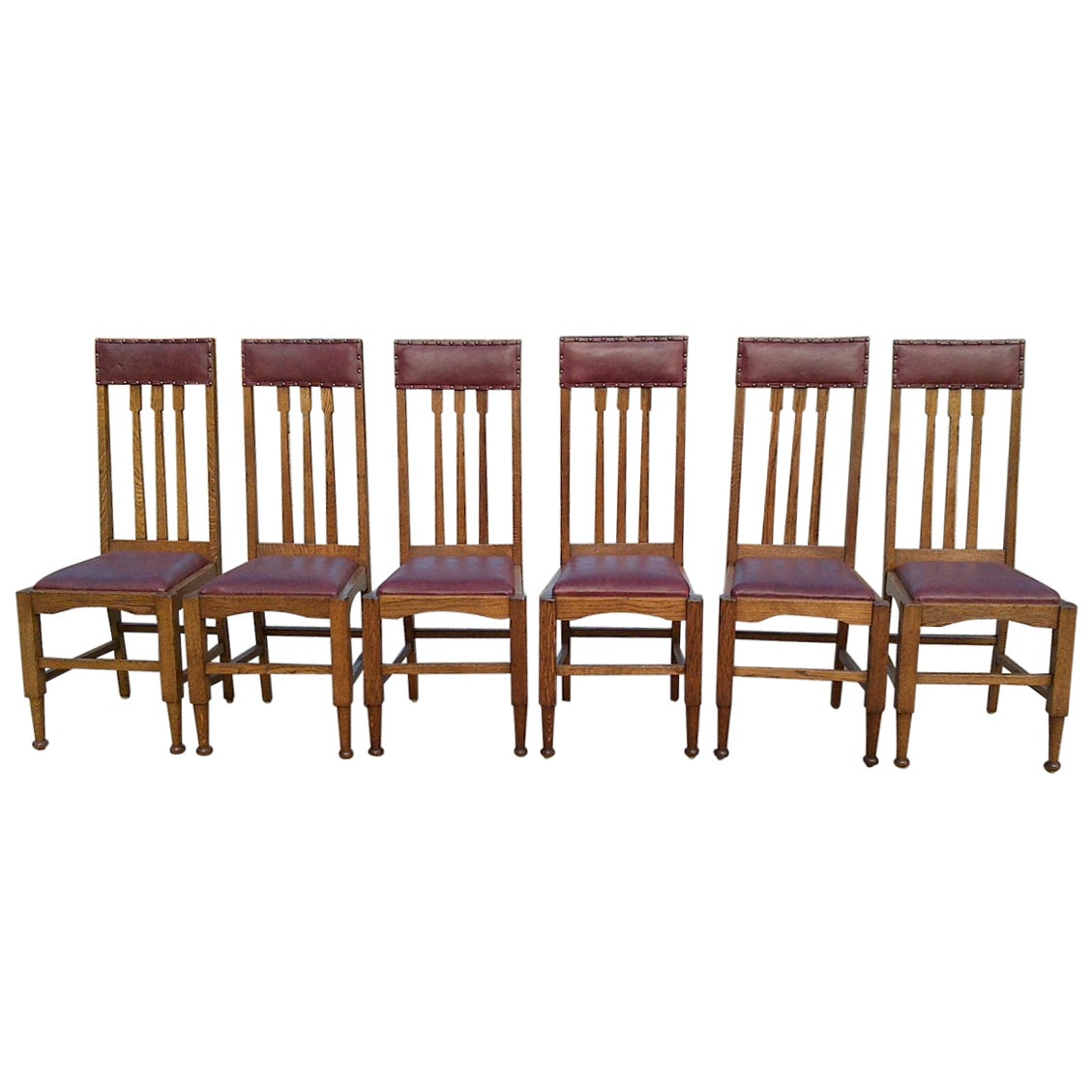 Eight Arts & Crafts Glasgow Style High Back Oak Dining Chairs with Leather Seats