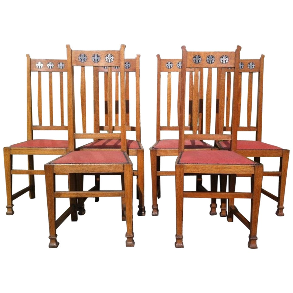 Wylie & Lochhead, Set of Six Arts & Crafts Oak Dining Chairs with Pewter Inlays