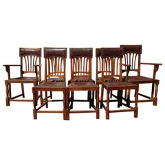 Shapland & Petter Attri a Set of Eight English Arts & Crafts Oak Dining Chairs