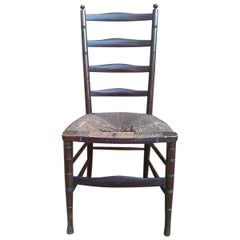 Liberty & Co. an English Aesthetic Movement Walnut Ladder Back Side Chair