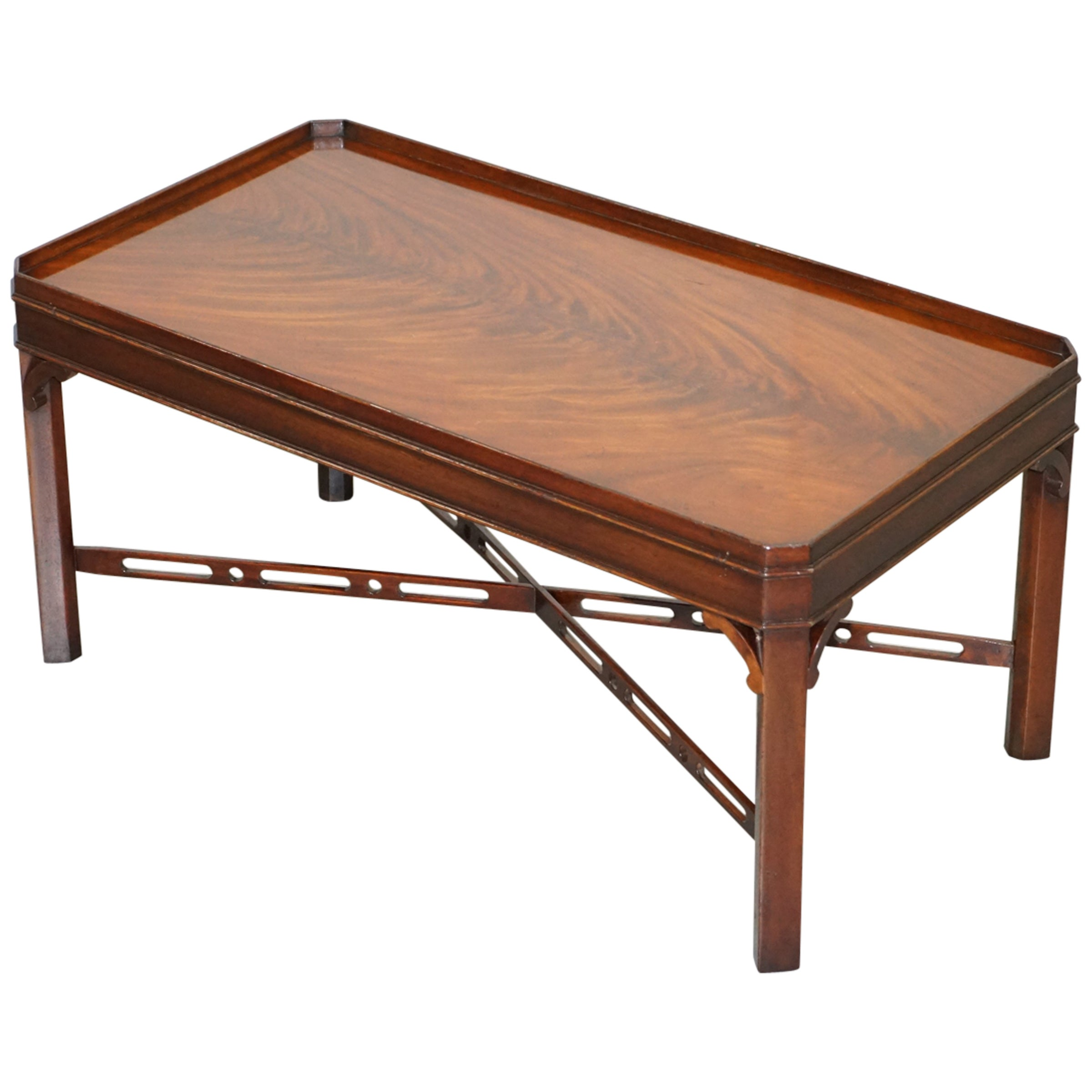 Stunning Flamed Mahogany Coffee or Cocktail Table Fret Work Carved Stretchers