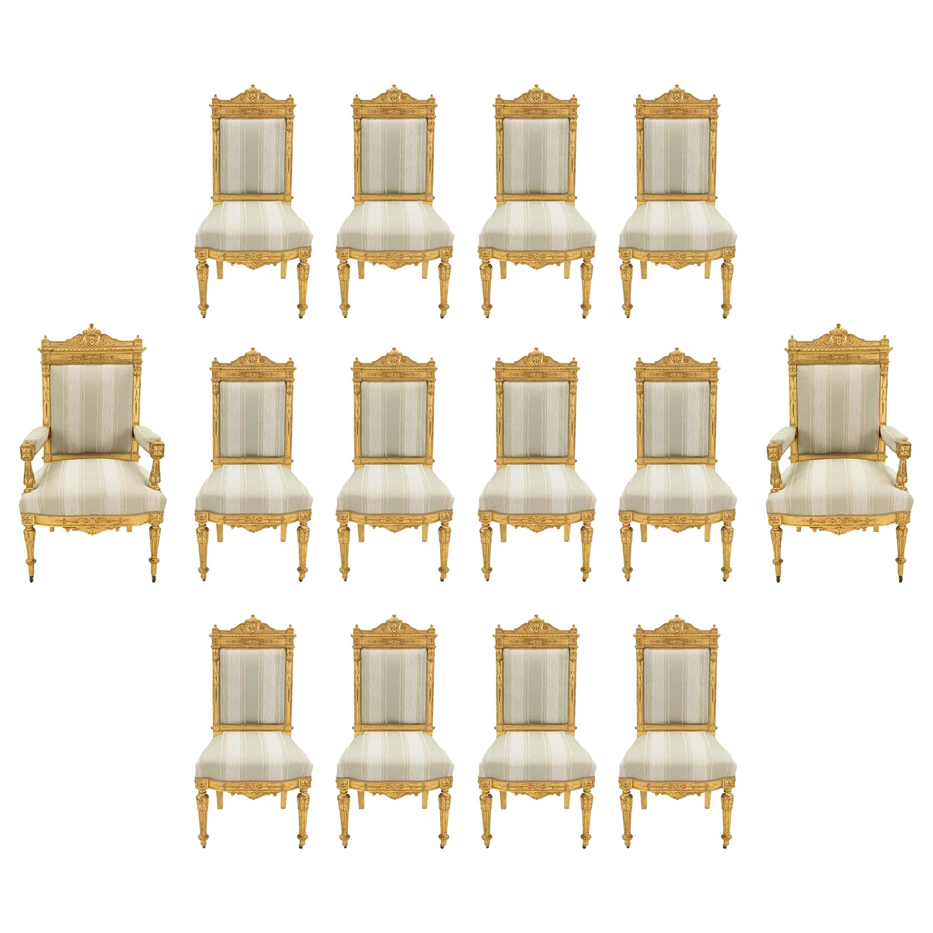 Set of Fourteen French 19th Century Louis XVI Style Giltwood Dining Chairs